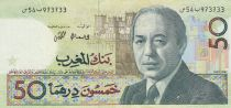 Maroc 50 Dirhams 1987 - Hassan II de face, charge militaire à cheval